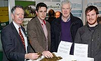 Pictured on the AgriSearch stand at the RUAS Winter Fair were from left: Dr Alan McIlmoyle; David Johnston DARD/AgriSearch PHD Student; Wallace Lyons and son George, Ballybogey. Photograph: Columba O'Hare