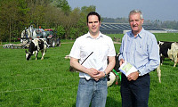 Dr Andrew Dale, AFBI, Hillsborough with AgriSearch chairman James Campbell, right, discussing how bag nitrogen input can be cut in half by applying slurry during the grazing season using the trailing-shoe technique